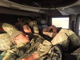 Photo of the day. Tired Kyrgyz border guards fall asleep in combat vehicle